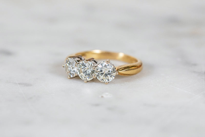 Diamond Trilogy Ring set in 18ct Yellow Gold