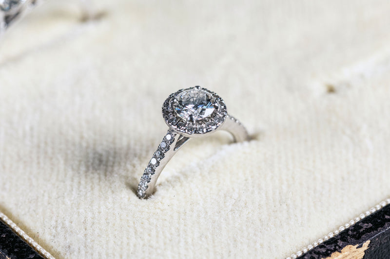 Diamond Solitaire Ring set with Diamond Halo and Diamond shank set in 18ct White Gold