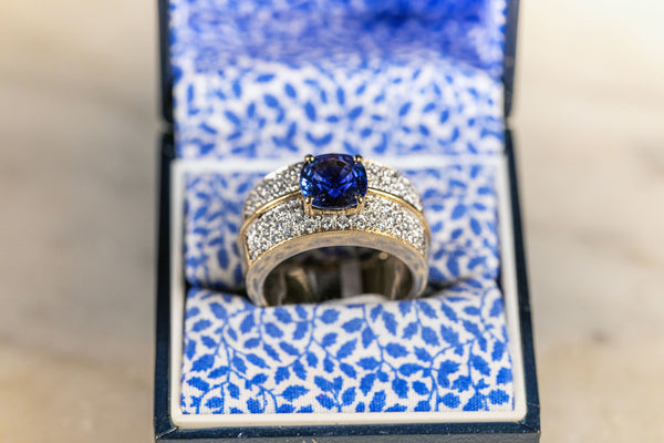 Oval Sapphire and Diamond Ring set in a wide 18ct Yellow Gold Band