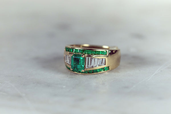 Emerald cut Emerald and Baguette Diamond Ring (1960's) set in 18ct Yellow Gold