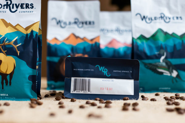 Coffee bags with roast date featured below one of the bags