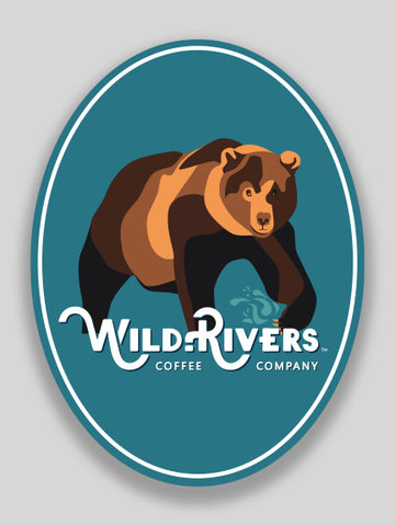 2.25 x 3 sticker of a bear and wild rivers logo on light blue background