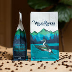 12 oz. Ethiopian coffee bag with a mountain scene and illustration of a Duck with Wild Rivers Logo. Tasting notes for this coffee include: Citrus, Honey, Dark Chocolate: Front and Side views of bag