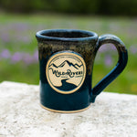 "Handmade, ceramic navy with rust color 12 oz mug with Wild Rivers Logo and ""Coffee for Conservation"" on the center"