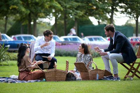 PLONK founders enjoying picnic and wine with friends, refer a friend