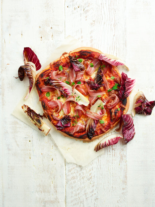 Pizza With Wild Boar Salami, Pancetta, Goat Cheese And Grilled Treviso