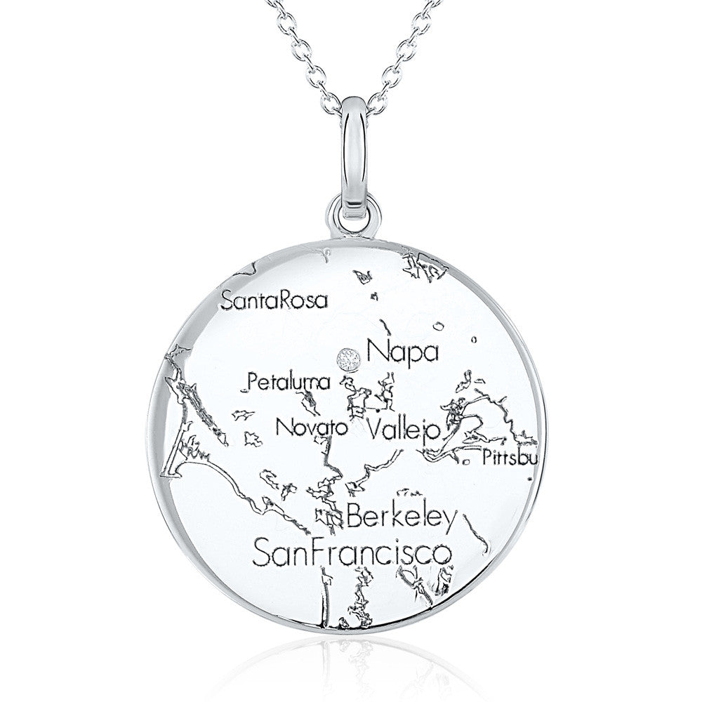 White Gold Round Map Pendant with a Diamond