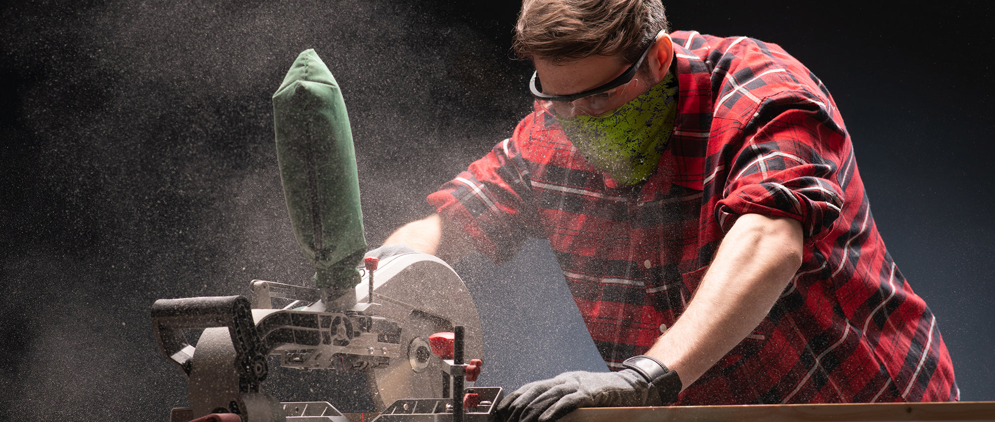Man using saw while wearing a Face Guard