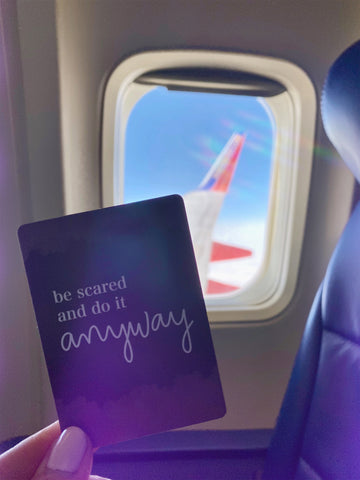 """""""Be scared and do it anyway"""" empowerment card airplane window message"""