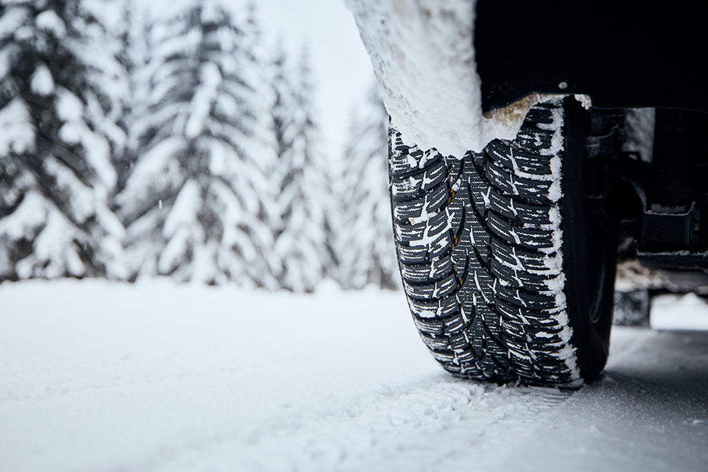 Icy tire on a snowy road