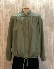 Load image into Gallery viewer, Wow! This jacket is so soft, it`s in a beautiful pastel green with a pale gold lining, tie bottom and a covered zip front and side pockets. It is a traditional 1980`s blouson style.  It is in very good condition with very little wear a great casual item jacket for any occasion.