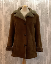 Load image into Gallery viewer, This thigh length sumptuous ladies sheepskin coat is very soft and easy to wear, with pure comfort and warmth and classic styling. The interior of the coat is a soft brown the collar a grey due to fading, but this does not effect the overall look of the coat. The velvety suede finish make it look very luxurious. Great coat for the winter month to keep you toasty and warm.