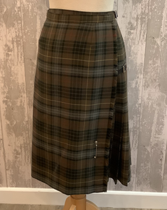 Traditional kilt with olive check. Made by Meclennans, Fort William. Pleated with kilt pin on the front panel. Would be warm in winter.