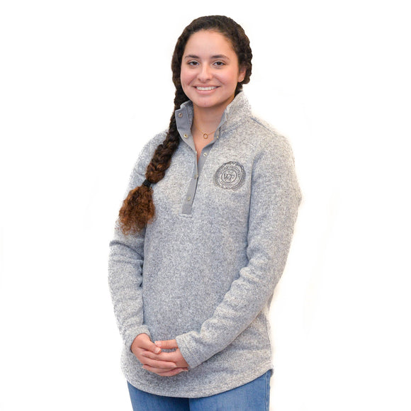 This tunic-length heathered fleece pullover is brushed on the inside for a super soft feel and features a stand-up collar and five snap flat metal closure, as well as the WEF Crest, embroidered on the left side of the chest.