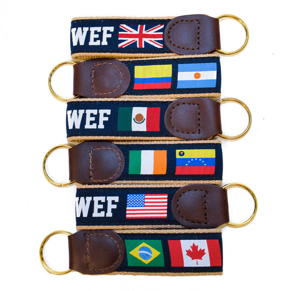 This nylon and canvas keychain is stitched together with genuine leather and features WEF in a block font, as well as multiple international flags and a brass keyring.