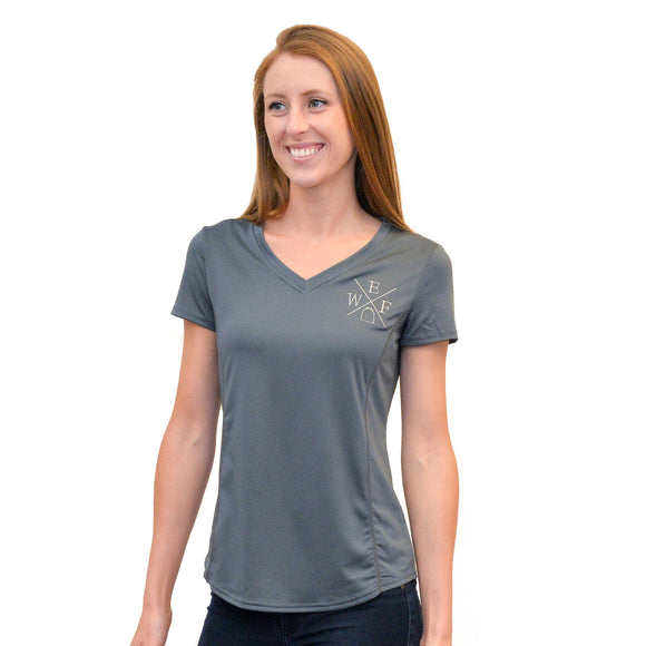 This short sleeve v-neck performance tee, made from moisture-wicking fabric with a rounded hemline and princess seams for a feminine fit, and features the WEF X embroidered on the left side of the chest.