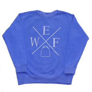 This soft-washed crew neck sweatshirt features a knit waistband and cuffs, while the WEF X is embroidered across the chest.