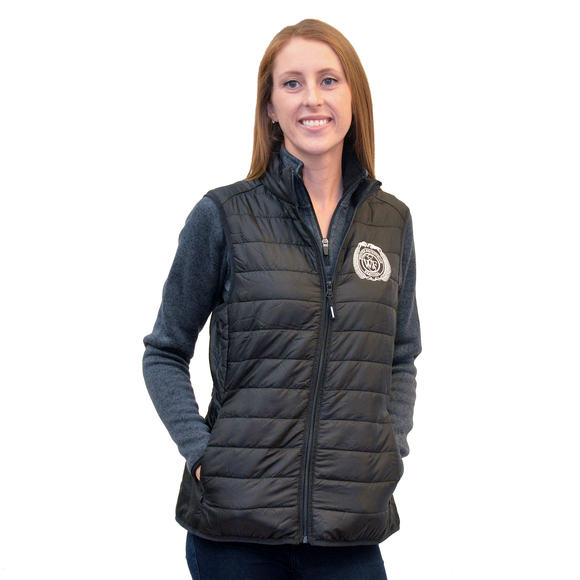 Warm and windproof this puffer vest, made of synthetic down, is incredibly lightweight and compressible. Perfect for packing in a backpack or suitcase, and features a full zip closure, two zip handwarmer pockets, a high collar, and the WEF Crest embroidered on the left side of the chest.