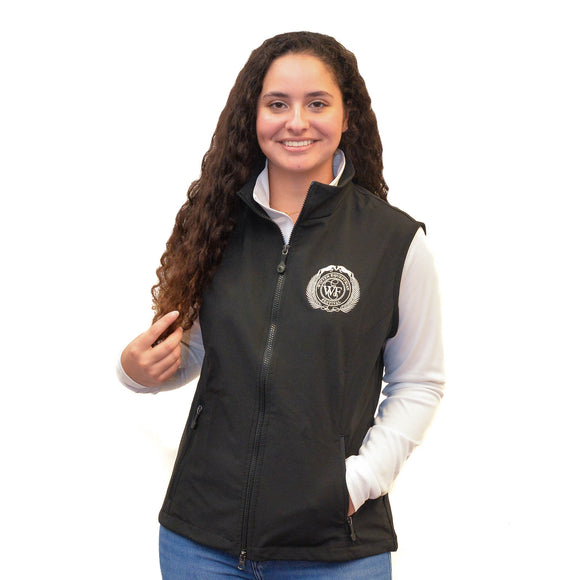 Lightweight and windproof, this full-zip vest features a warm fleece lining, exterior handwarmer zip pockets, a cadet collar, princess seams for a feminine fit, and the WEF Crest embroidered on the left side of the chest.