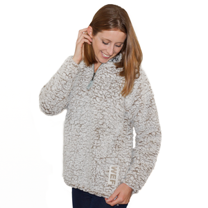 This super-soft sherpa quarter-zip pullover is what cozy dreams are made of! Featuring a stand-up collar lined in contrast coloring, fitted cuffs, the WEF Block embroidered vertically on the left hip.