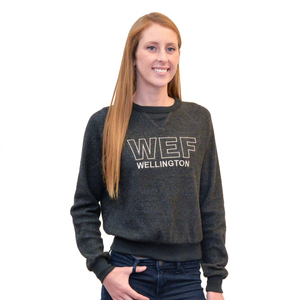 Cropped and casual, this soft reverse fleece crew neck sweatshirt features a raglan silhouette with ribbed cuffs and waistband, as well as WEF Wellington in block font embroidered across the chest.