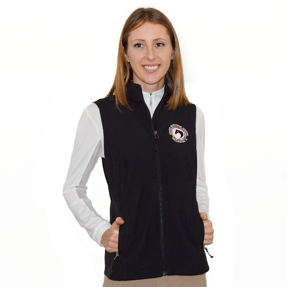 Lightweight and windproof, this full-zip vest features a warm fleece lining, exterior handwarmer zip pockets, a cadet collar, princess seams for a feminine fit, as well as the WEF Flags emblem embroidered on the left side of the chest.
