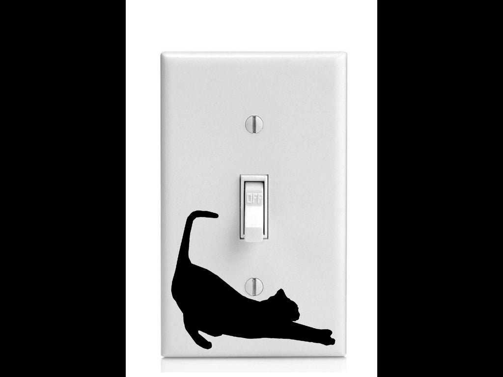 Stretching Kitty Cat on Light Switch Cover