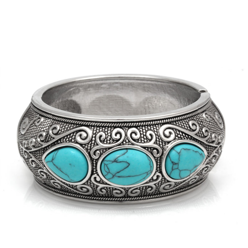 This Bracelet Features Pear Shape Turquoise Stones As Its Center. This Hinged Bracelet Is In Oxidized Silver Finish That Creates Vintage Look.