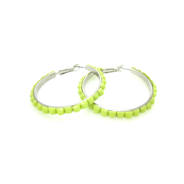 These hoop earrings are absolutely darling. Trimmed with faceted beads that glisten with your every move.