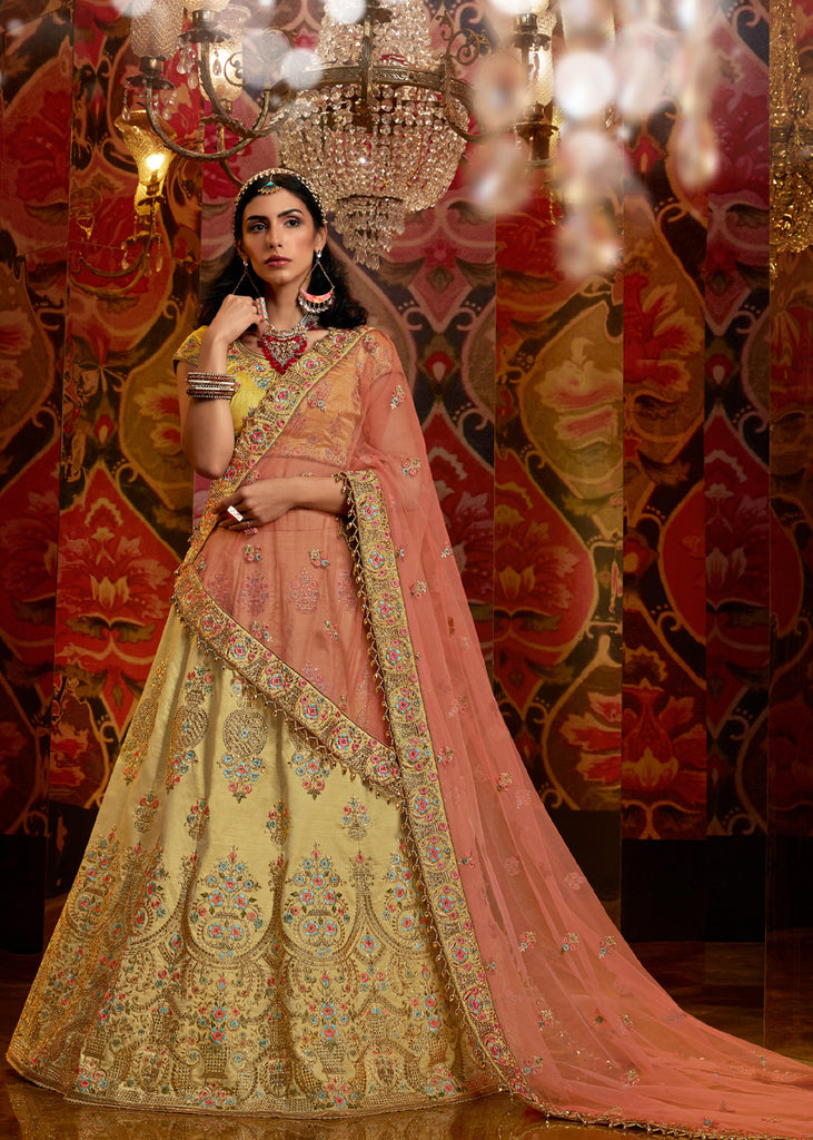 PRE ORDER:ROYAL YELLOW RAW SILK HEAVY LEHENGA WITH EMBROIDERED BLOUSE AND PEACH DUPATTA