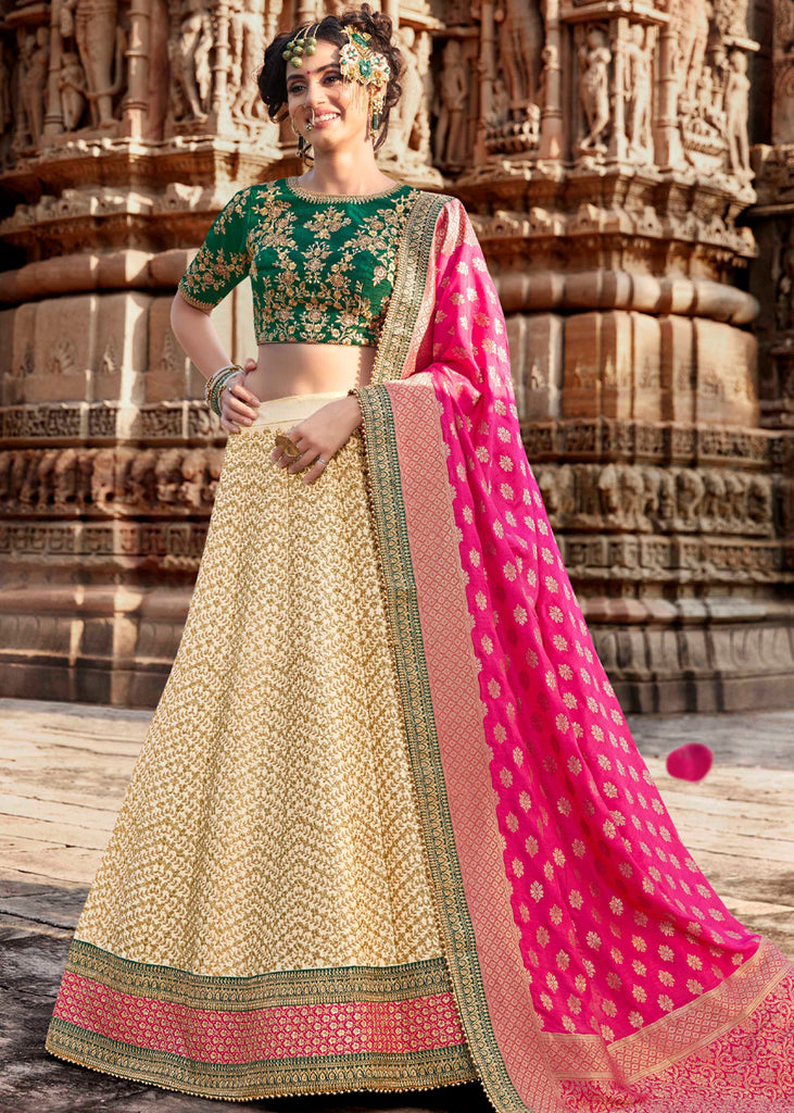 BEIGE HEAVY EMBROIDERED LEHENGA WITH CONTRAST GREEN BLOUSE AND RANI PINK DUPATTA