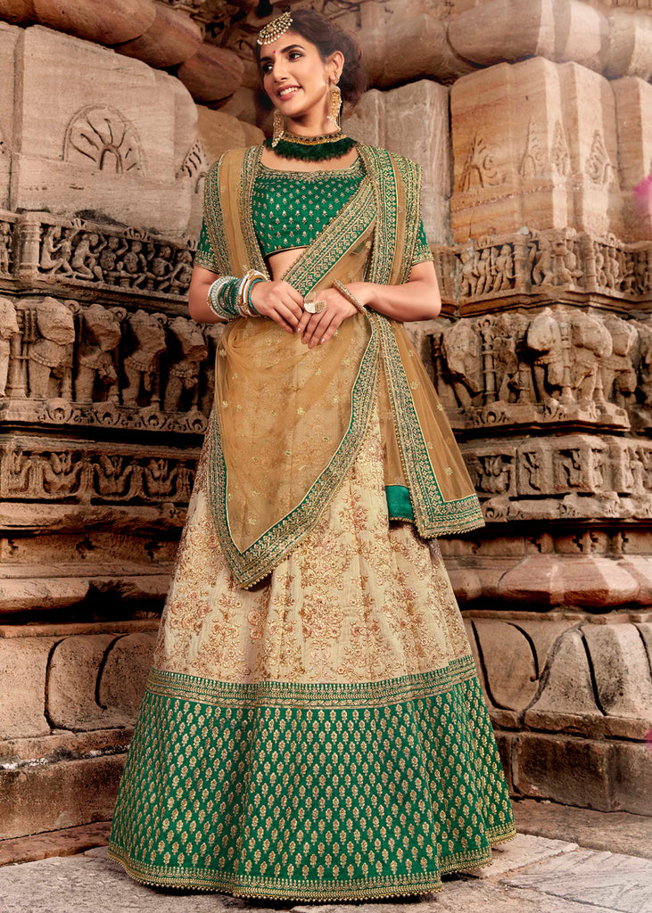 BEIGE AND GREEN HEAVY EMBROIDERED LEHENGA WITH BEAUTIFUL BLOUSE AND DUPATTA
