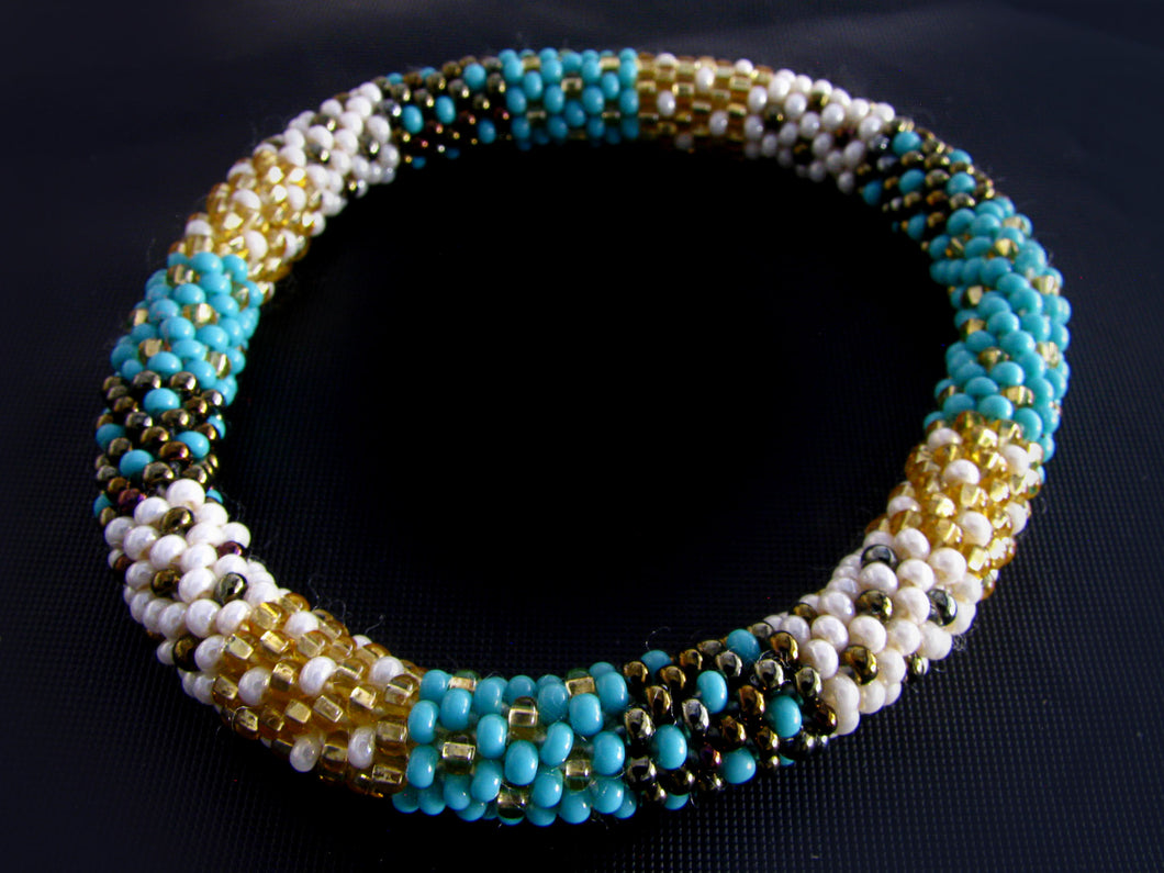 Turquoise, Gold & Bronze Roll-on Bracelet