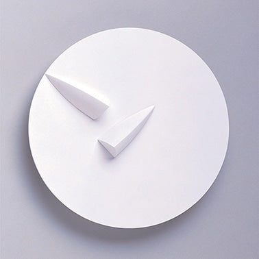 The hour hand keeps time from the clock's center while the minute hand orbits around. The minute hand does not appear to be attached to the axis. In actuality, it is attached to the disk that makes up the clock face. As the disk is featureless, and perfectly round, it appears to be motionless. Self-produced prototype.