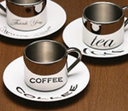 The distorted image on the ceramic saucer can only be viewed correctly in the curved reflective surfaces of the stainless steel cup. The image is indecipherable when the cup and saucer are separate. Produced by Free-Wings Co., Ltd.