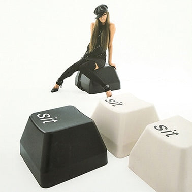 This stackable injection molded Command Sit stool comes in generic computer beige, and black. Produced by Duende.