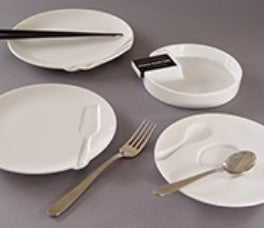 The basic forms in this series are generic, with the exception that each is paired with, and indented by an appropriate utensil. The Ø20cm plate pares with chopsticks. The Ø18cm plate pares with a fork. The Ø16cm saucer pares with a spoon, and the Ø14cm ashtray has a recess to accommodate a box of matches. Self-produced. Made in porcelain by Takito Co., Ltd.