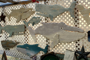 Large hand carved wooden whales