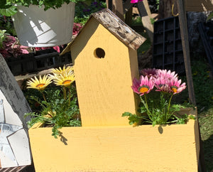Double birdhouse planter