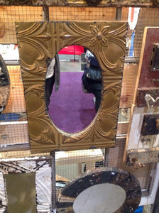 Antique embossed tin oval mirrors