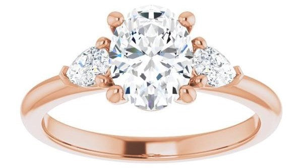 Oval Three Stone Diamond and Gold Engagement Ring