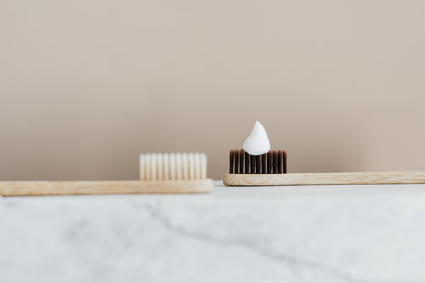 Wooden toothbrush with toothpaste