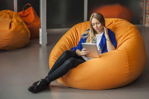 woman-sitting-comfortably-in-a-bean-bag
