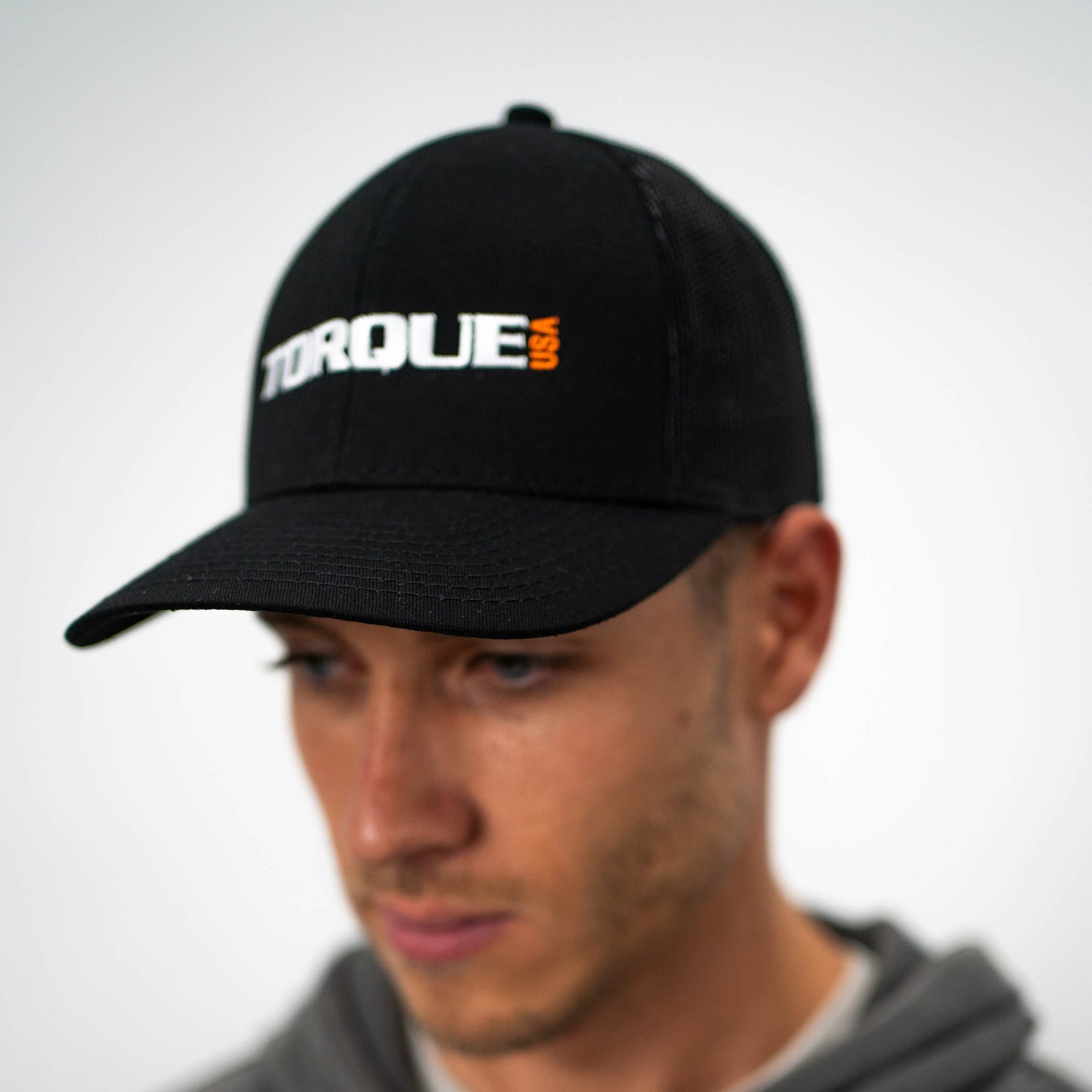 Man wearing black Torque baseball hat