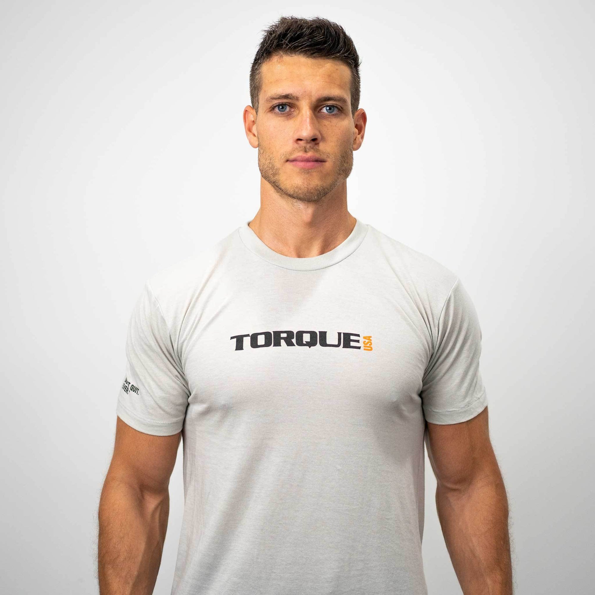 Man wearing white Torque t-shirt