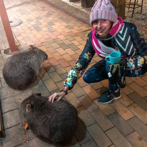 Me with animals - wombats that I met in Australia that made me plant trees in Australia
