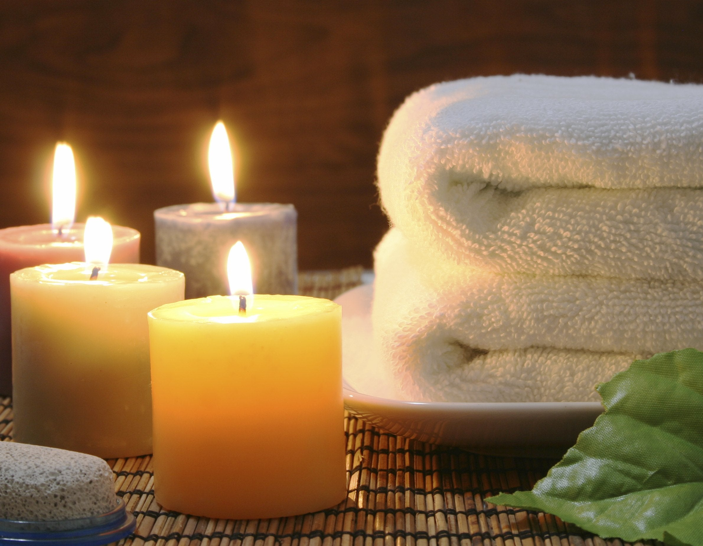 Towel, aromatic candles and other spa objects to make mood relaxing