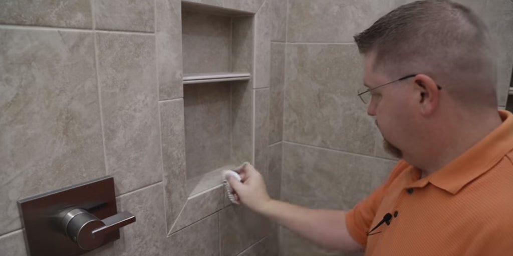 grout removal in wet room shower enclosure
