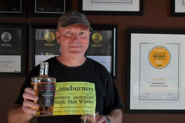 Ben Kagi with a bottle of Limeburners whisky in his hands