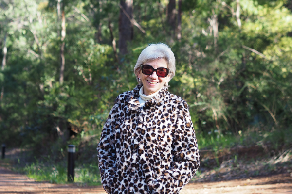 Diane Slade with trees in the background